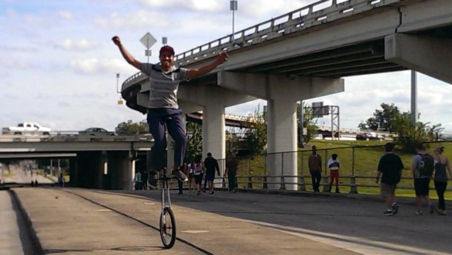 Unicyclist on Alabama near Dowling. Photo: Sunday Streets HTX.