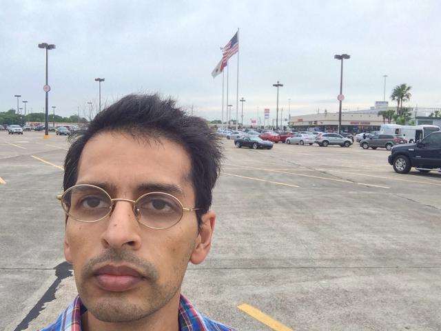 Selfie of almost missing bus  (in right corner) while taking selfie.
