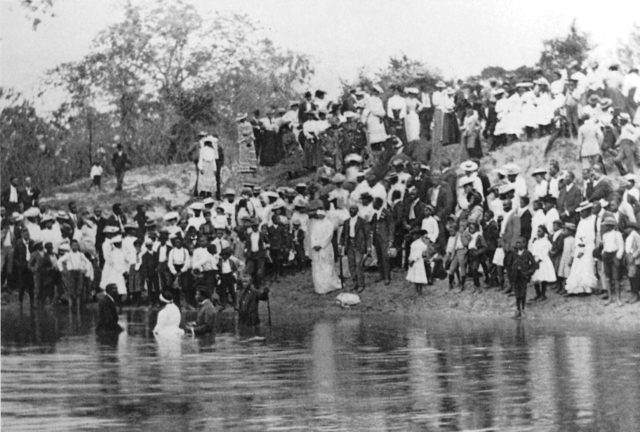 Houston's bayous have long been places to gather and, as seen in this circa-1904 photo, to be baptized. Photo: George Fuermann City of Houston Collection, University of Houston.