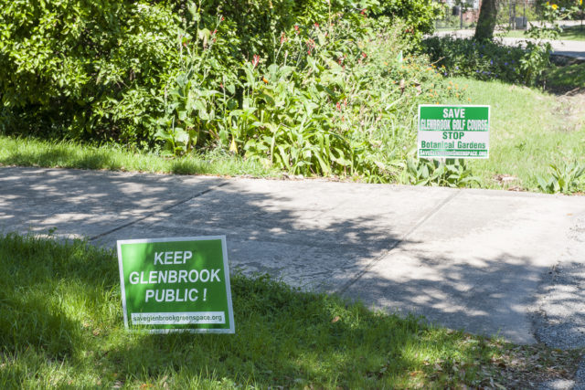Yard signs near pedestrian entrance to Glenbrook Golf Course. Photo by Paul Hester.