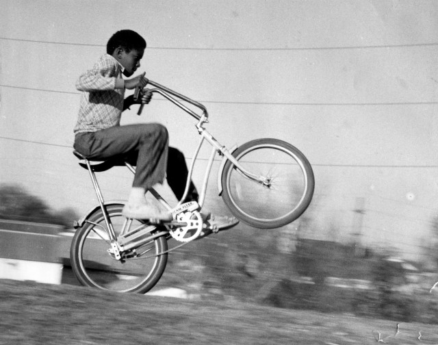Phil Leon captured this image of a New Orleans or Texas neighbor performing a wheelie sometime in the 1970s. Photo: Kumar McMillan under a Creative Commons Attribution-ShareAlike 2.0 Generic License.